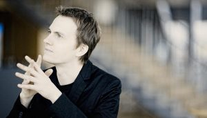 Alexandre Tharaud poses for a portrait looking off into the distance