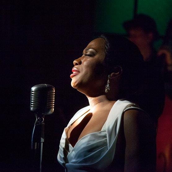 alexis roston singing on stage