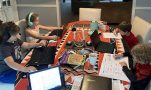 kids work around a table at home