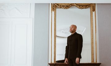 portrait of aaron diehl reflected in a white room