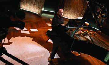 Igor Levit playing piano on stage