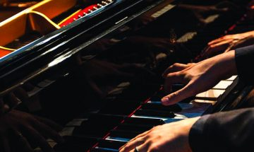 close up of pianists hands