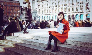 Rachel Naomi Kudo sits on steps for a portrait