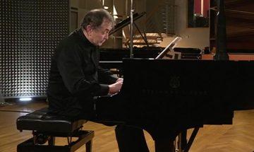 Aimard playing piano in studio