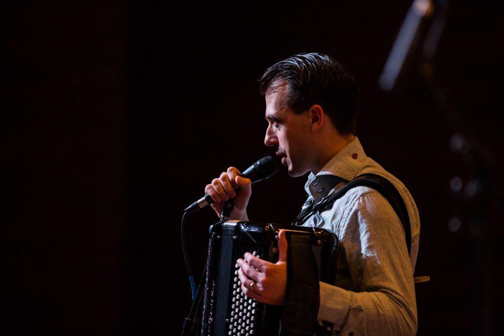 Julien Labrio on microphone