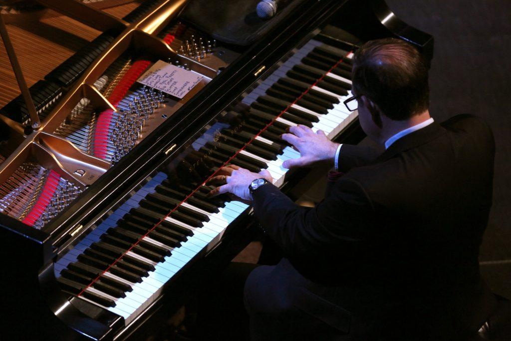 aerial shot of Bill Charlap Trio pianist performing